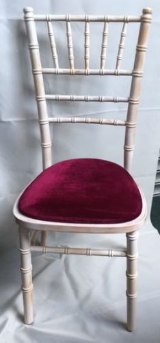 Limewash Chiavari chair with burgundy pad