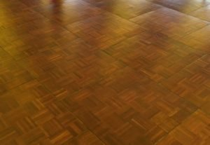 Dark oak parquet dancefloor